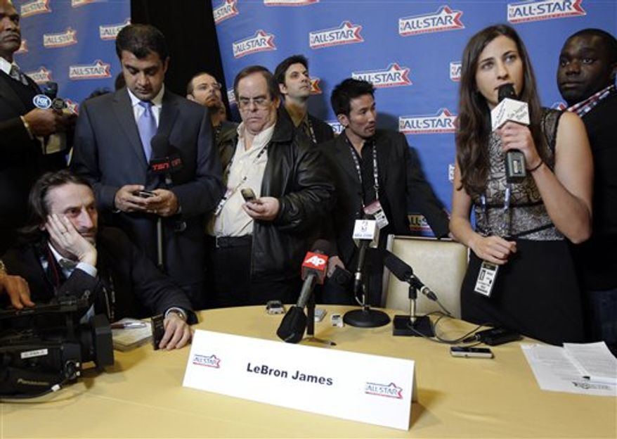 Miami Heat's LeBron James talks to reporters during media availability for the NBA All Star basketball game in Los Angeles, Friday, Feb. 18, 2011. (AP Photo/Jae C. Hong)