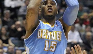 Denver Nuggets' Carmelo Anthony (15) shoots against the Milwaukee Bucks during the first half of an NBA basketball game Wednesday, Feb. 16, 2011, in Milwaukee.  (AP Photo/Jim Prisching)