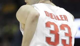 In this March 21, 2010, photo, Ohio State's Jon Diebler signals after making a 3-point basket during an NCAA tournament second-round college basketball game in Milwaukee. On Sunday, Feb. 20, Diebler could set the Big Ten record for 3-pointers made, when Ohio State plays at Purdue. (AP Photo/Morry Gash)
