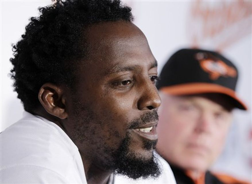 Baltimore Orioles' Vladimir Guerrero  walks out of the batting cage during baseball spring training, Friday, Feb. 18, 2011 in Sarasota, Fla.  (AP Photo/Eric Gay)