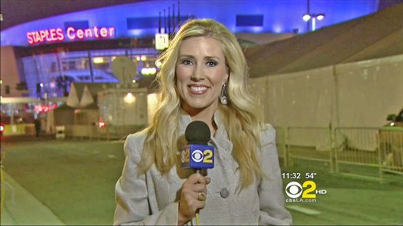 FILE - In this Sunday, Feb .13, 2011 undated handout file photo provided  by KCBS in Los Angeles, veteran TV journalist Serene Branson reports on the Grammy awards show outside the Staples Center in Los Angeles. Branson's speech became incoherent during the stand-up, which fueled Internet speculation that she suffered an on-air stroke. Doctors said Thursday that she suffered a migraine, the symptoms of which can mimic a stroke. (AP Photo/KCBS TV) NO SALES