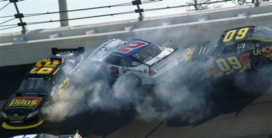 Drivers Michael Annett (62), Elliott Sadler (2), and Kenny Wallace (09) crash during the DRIVE4COPD 300 NASCAR Nationwide series auto race at Daytona International Speedway in Daytona Beach, Fla., Saturday, Feb. 19, 2011. (AP Photo/Russell Williams)