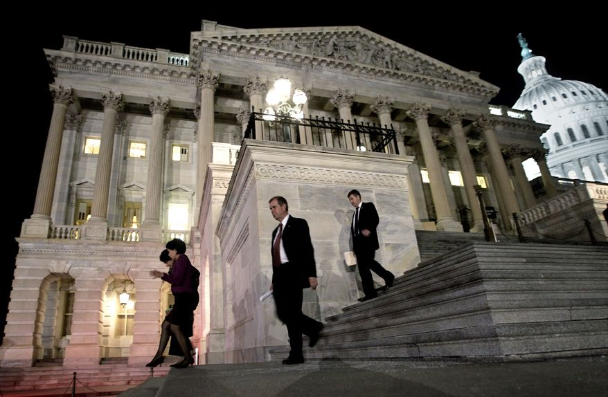 Congressmen walk down the steps of the House of Representatives as they work throughout the night on a spending bill, on Capitol Hill in Washington on Friday, Feb. 18, 2011 (AP Photo/J. Scott Applewhite)