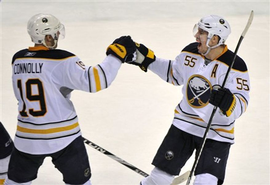 Buffalo Sabres' Jochen Hecht, right, celebrates his winning goal in the shootout against the Montreal Canadiens with teammate Tim Connolly during an NHL hockey game Tuesday, Feb. 15, 2011, in Montreal. Buffalo won 3-2. (AP Photo/The Canadian Press, Paul Chiasson)