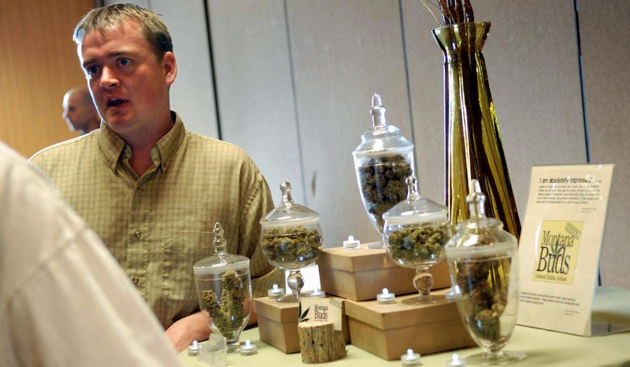 Chuck Campbell, with Montana Buds, talks with a new card holder about the services he offers, as part of a so-called cannabis caravan in Helena, Mont. Some Montanans have had enough of medical marijuana, saying their state's image as a rugged cowboy frontier is being replaced by a fast-growing pot culture. (Associated Press)