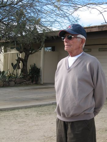 George Gayan, a neighbor of Amy and Randy Loughner's, who are the parents of accused mass shooter Jared Lee Loughner, stands near the Loughner home in Tucson, Ariz., on Friday, Feb. 18, 2011. (AP Photo/Allen Breed)
