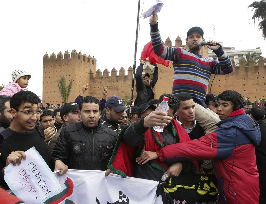 Protesters march during a demonstration on Sunday in Rabat, Morocco. At least 2,000 people marched in Morocco's capital to demand a new constitution that would bring greater democracy in the North African kingdom. Demonstrators shouted slogans calling for economic opportunity, educational reform, better health services and help in coping with rising living costs during the march on central Hassan II Avenue in Rabat. At left the banner reads: ''Makhzen Get Out'' Makhzen is a Moroccan Arabic term for the governing elite in Morocco. (Associated Press)