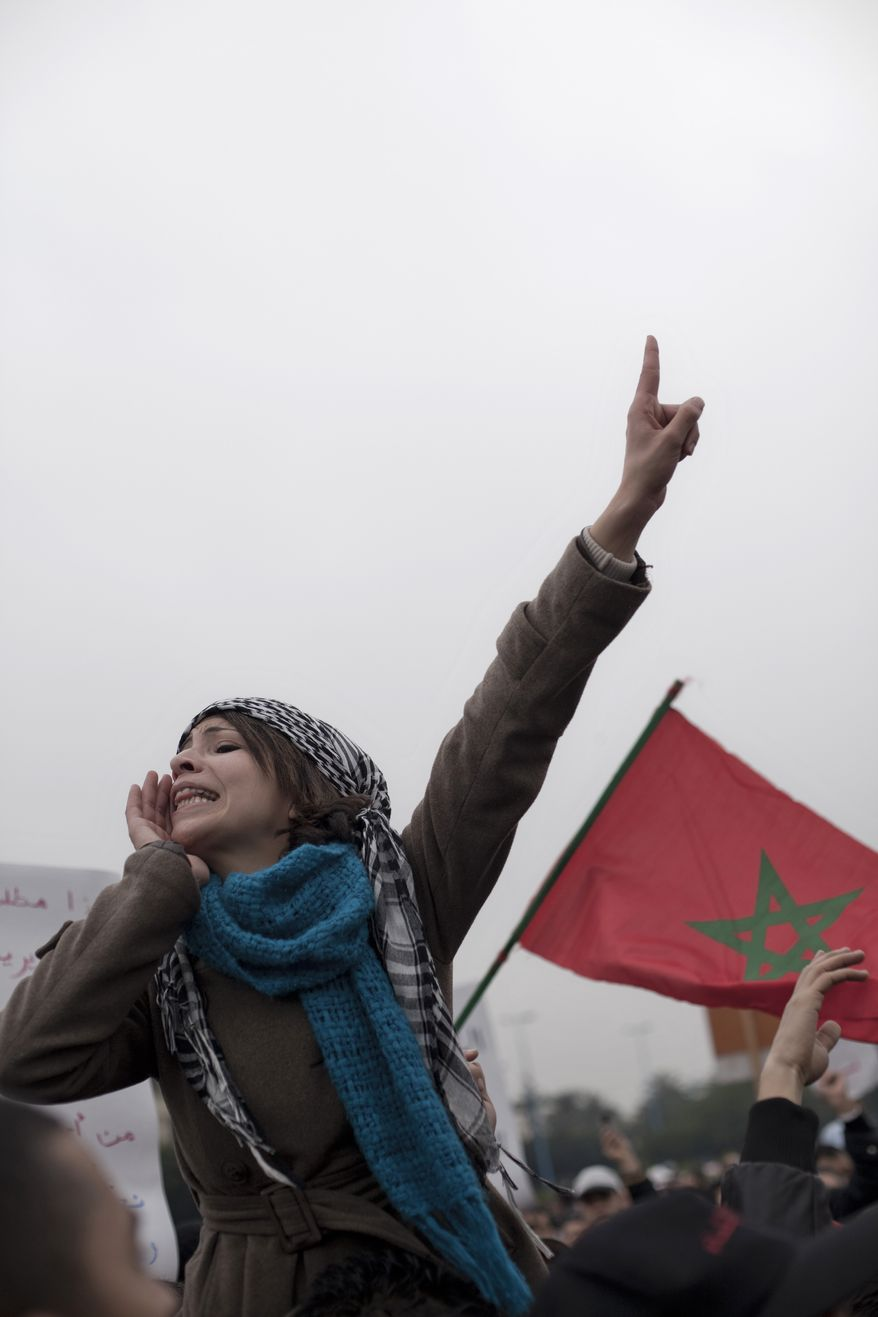 Protesters are seen during a demonstration on Sunday in Casablanca, Morocco. Thousands of people marched in cities across Morocco, demanding a new constitution to bring more democracy in the North African kingdom amid the wave of Arab world upheaval. (Associated Press)