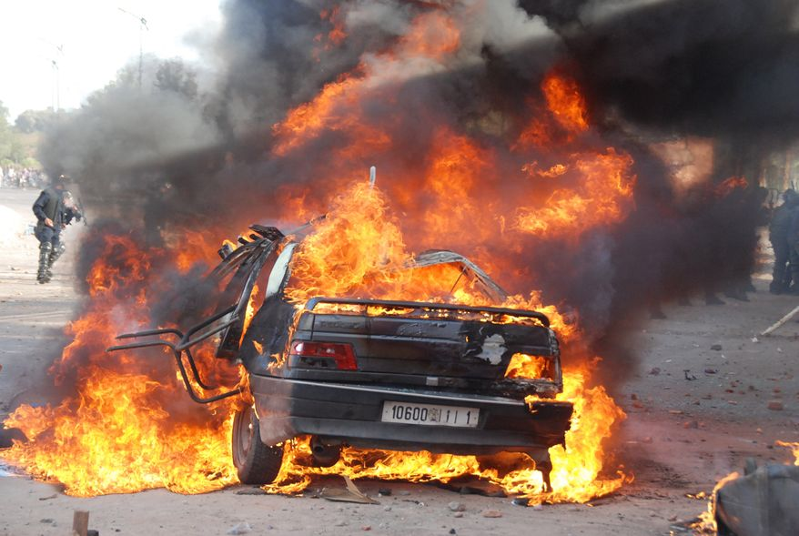 A car is burned during a demonstration on Sunday in Marrakech, one of a string of nationwide protests that brought thousands to the streets across Morocco. Thousands of people marched in cities across Morocco on Sunday, demanding a new constitution to bring more democracy in the North African kingdom amid the wave of Arab world upheaval. (Associated Press)