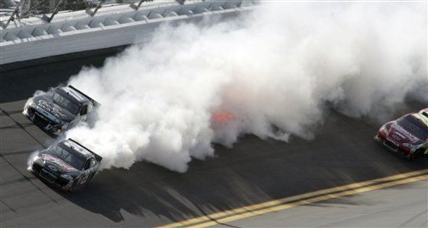 Smoke billows from Kevin Harvick's car (29) after an engine problem during the Daytona 500 NASCAR auto race at Daytona International Speedway in Daytona Beach, Fla., Sunday, Feb. 20, 2011. (AP Photo/Jim Topper)