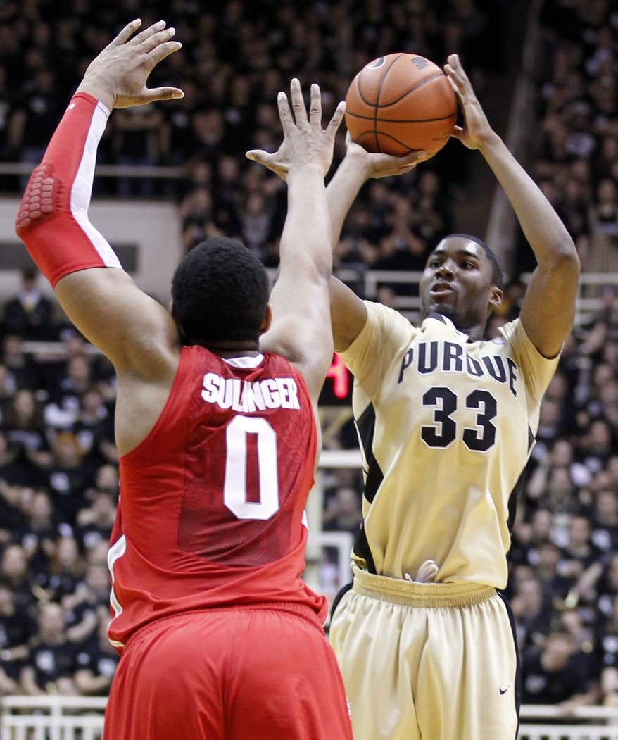 Purdue guard E'Twaun Moore (right) shoots over Ohio State forward Jared Sullinger in the second half of  Purdue's 76-63 home win on Sunday. Moore score 38 points in the victory. (Associated Press)
