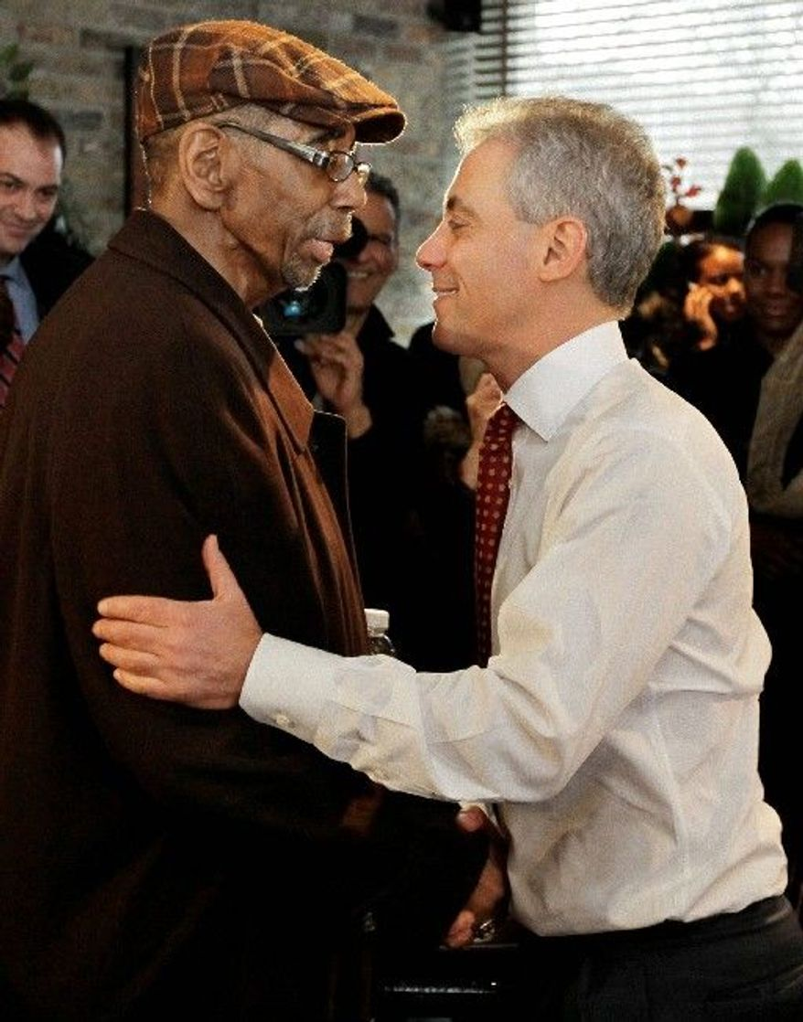 Chicago mayoral candidate Rahm Emanuel (right) is greeted by U.S. Rep. Bobby L. Rush as Mr. Emanuel arrives at Chicago's Home of Chicken and Waffles for lunch Monday. (Associated Press)