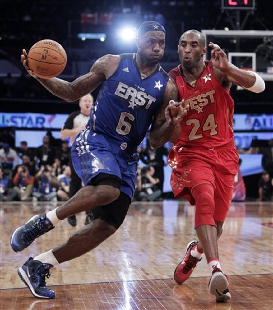 East's LeBron James, of the Miami Heat, drives down to the basket while being guarded by West's Kobe Bryant, of the Los Angeles Lakers, during the second half of the NBA basketball All-Star Game on Sunday, Feb. 20, 2011, in Los Angeles.  (AP Photo/Jae C. Hong)