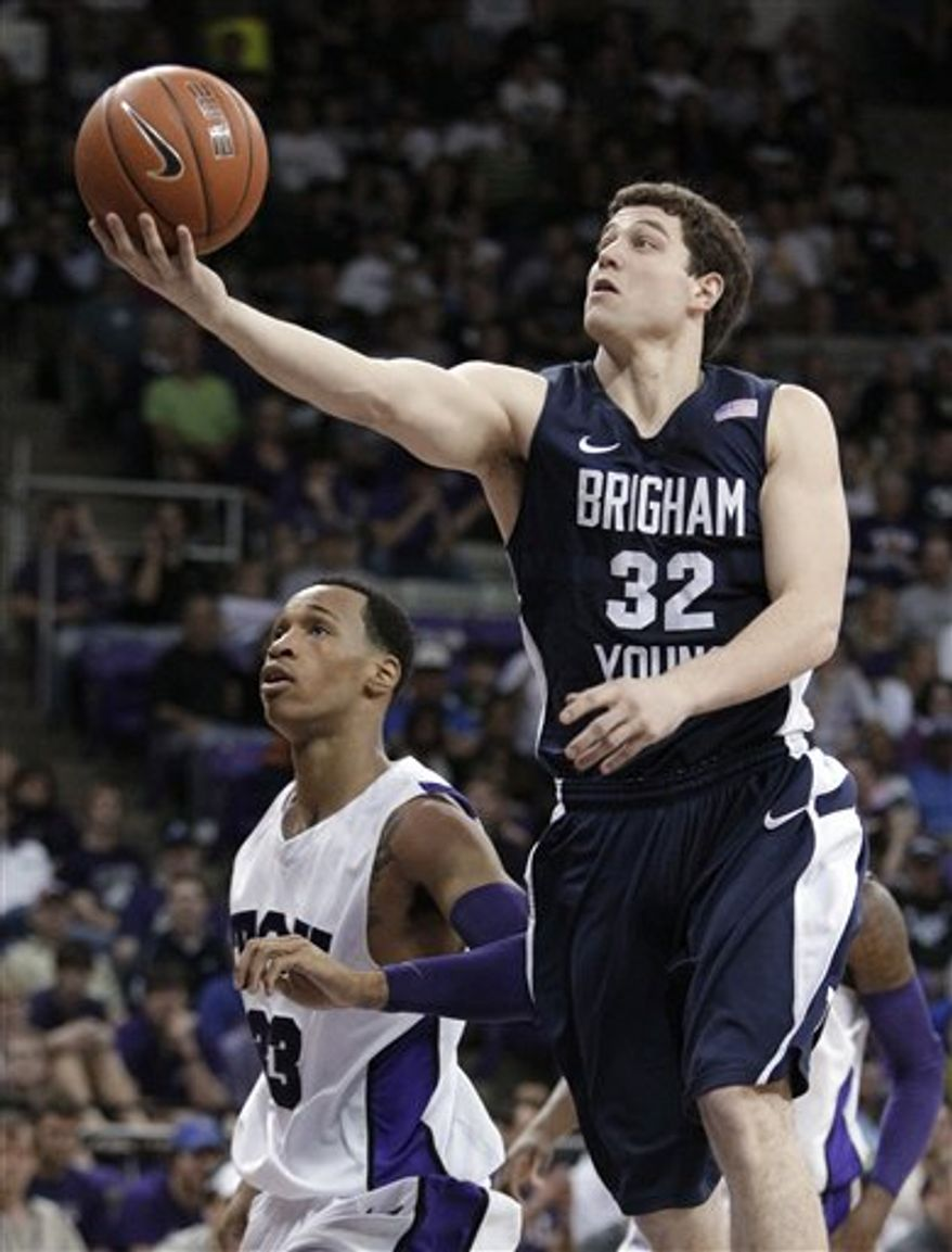 BYU guard Jimmer Fredette (32) shoots over TCU 's J.R. Cadot (23) in the second half of an NCAA college basketball game Saturday, Feb. 19, 2011, in Fort Worth, Texas. Fredette had a game-high 23-points in the 79-56 BYU win. (AP Photo/Tony Gutierrez)