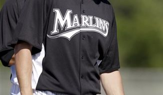 Florida Marlins starting pitcher Josh Johnson listens to instructions before taking part in a drill during spring training baseball Friday, Feb. 18, 2011, in Jupiter, Fla. (AP Photo/Jeff Roberson)