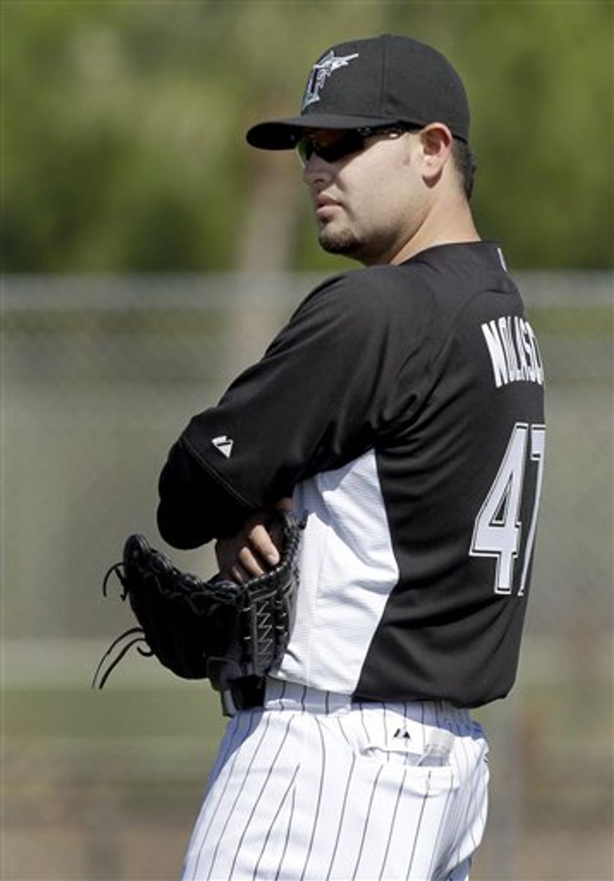 Florida Marlins pitcher Randy Choate throws to third during a drill at spring training baseball Friday, Feb. 18, 2011, in Jupiter, Fla. (AP Photo/Jeff Roberson)