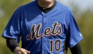 New York Mets first baseman Daniel Murphy, left, laughs as he warms up under the watchful eye of manager Terry Collins during spring training baseball, Monday, Feb. 21, 2011, in Port St. Lucie, Fla. (AP Photo/Jeff Roberson)