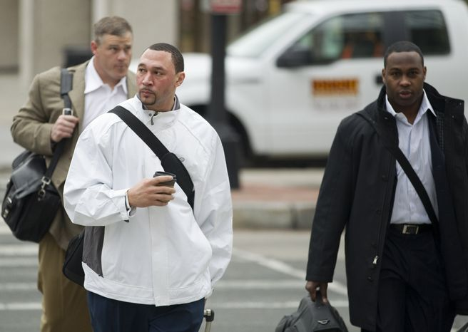 Pittsburgh Steelers quarterback Charlie Batch (center), New York Jets fullback Tony Richardson (right) and former NFL player Pete Kendall arrive for talks on the NFL labor deal on Monday in Washington. After months of infrequent, and sometimes contentious bargaining, the league and union have met every day since Friday, to come to terms over a series of issues, not least of which is how to divide about $9