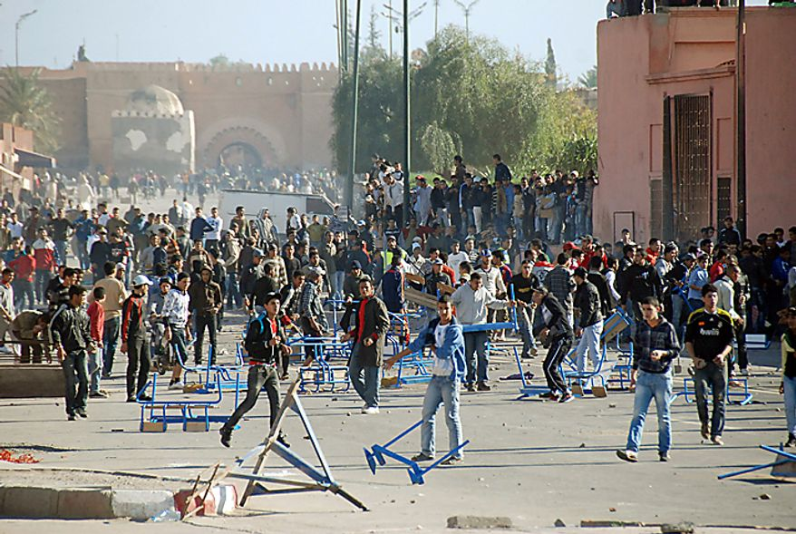 Protesters take to the streets in Marrakech, Morocco, in one of a string of nationwide protests that brought out thousands of demonstrators across Morocco on Sunday, Feb. 20, 2011, in an effort to push for greater democracy and constitutional reform. Protesters in Morocco and other Arab nations may also be wary as they watch Tunisia and Egypt grapple with the challenges of building a new system and maintaining order after breaking free of autocrats. (AP Photo/Tarik Najmaoui)