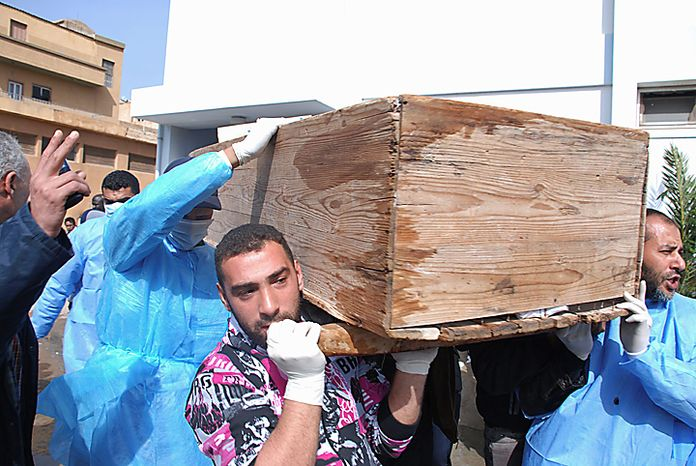 Men carry a coffin at Al-Jalaa Hospital in Benghazi, Libya, on Monday, Feb. 21, 2011. Libyan protesters celebrated in the streets of Benghazi on Monday, claiming control of the country's second-largest city after bloody fighting, and anti-governmen