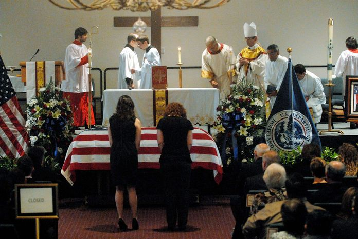 The casket of slain Immigration and Customs Enforcement Agent Jaime Zapata, 32, sits at the front of the Brownsville Events Center in Brownsville, Texas, Tuesday during a funeral Mass attended by more than 1,