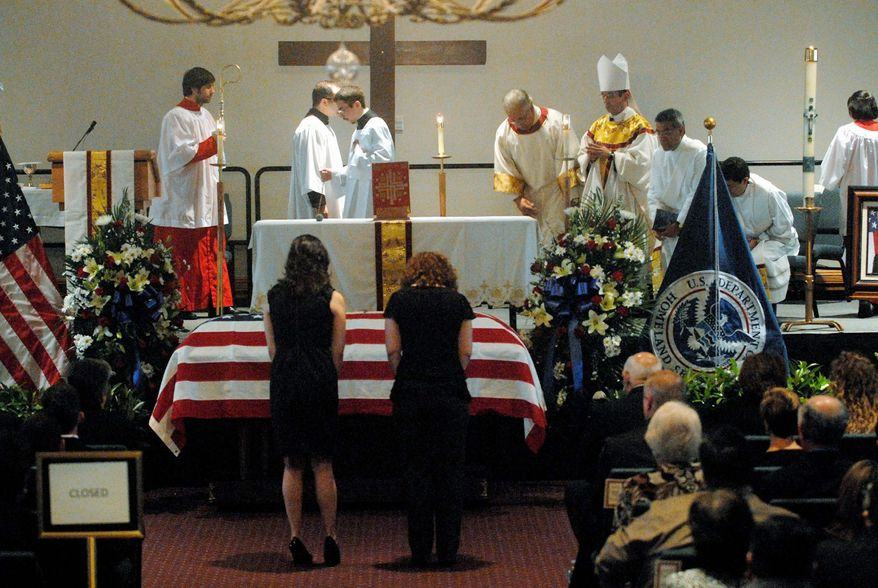 The casket of slain Immigration and Customs Enforcement Agent Jaime Zapata, 32, sits at the front of the Brownsville Events Center in Brownsville, Texas, Tuesday during a funeral Mass attended by more than 1,000 people. He and his partner were ambushed on the road in Mexico. (Associated Press)