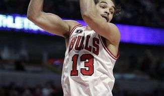 FILE - This Dec. 4, 2010, file photo shows Chicago Bulls' Joakim Noah rebounding the ball during the first quarter of an NBA basketball game against the Houston Rockets,  in Chicago. Sidelined by a thumb injury, the center is expected to play when the Central-leading Bulls visit the Toronto Raptors on Wednesday, Feb. 23, 2011. (AP Photo/Nam Y. Huh, File)
