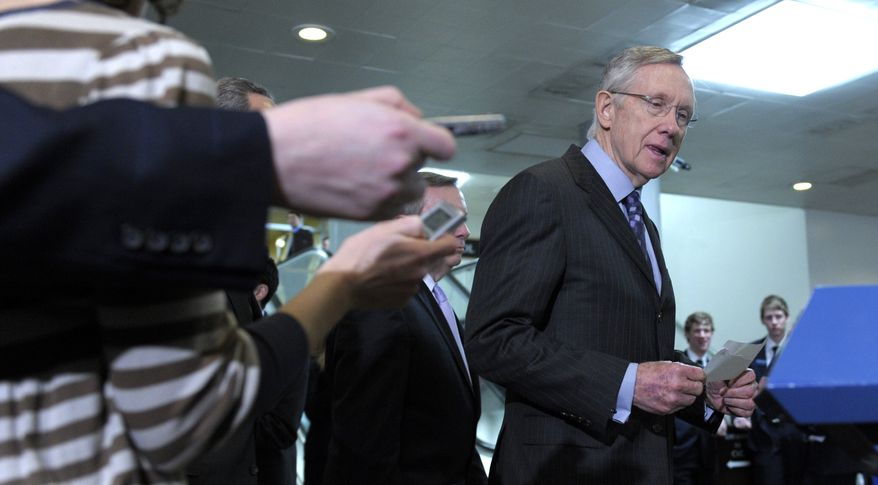 Senate Majority Leader Harry Reid, Nevada Democrat, arrives Thursday for a news conference on Capitol Hill to respond to a statement made by House Speaker John Boehner of Ohio. (Associated Press)
