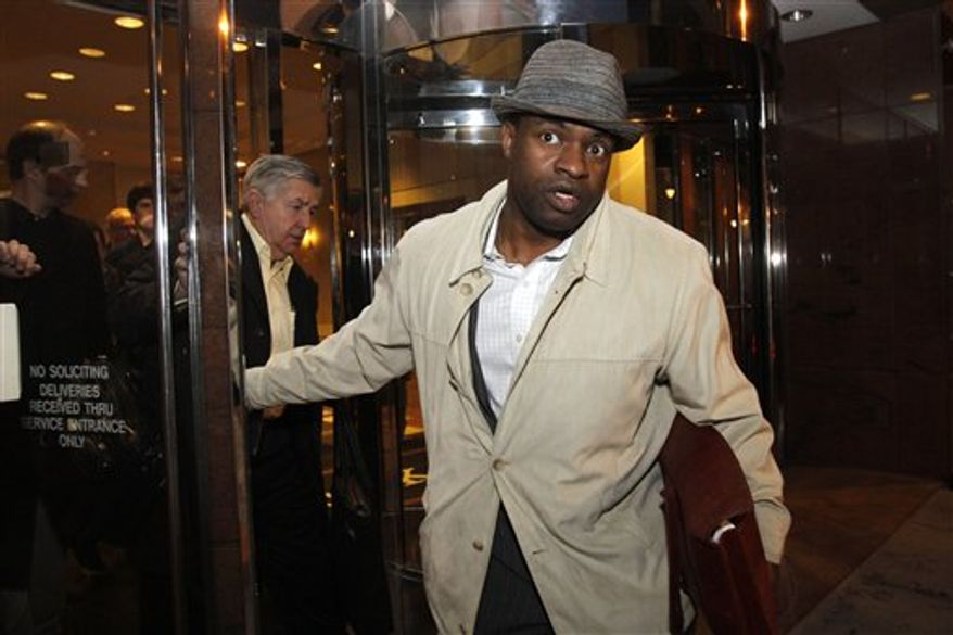 NFL Players Association Executive Director DeMaurice Smith exits an NFL/NFLPA mediation session at Federal Mediation and Conciliation Service headquarters in Washington, Monday, Feb. 21, 2011. (AP Photo/Jacquelyn Martin)