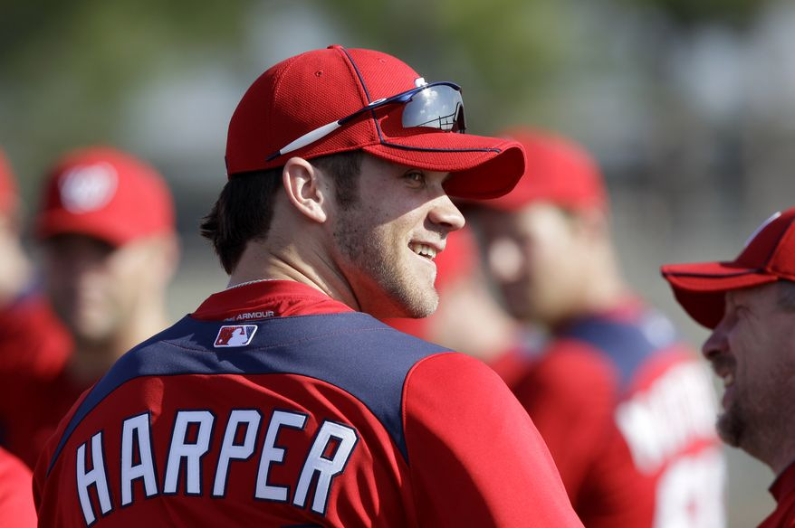 Washington Nationals right fielder Bryce Harper smiles as he talks with teammates before the start of a spring training baseball workout Tuesday, Feb. 22, 2011, in Viera, Fla. (AP Photo/David J. Phillip)