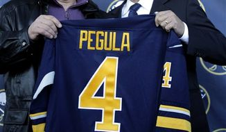Buffalo Sabres owner Terry Pegula, right, talks with NHL commissioner Gary Bettman during a news conference announcing the new ownership of the NHL hockey team in Buffalo, N.Y., Tuesday, Feb. 22, 2011. (AP Photo/David Duprey)