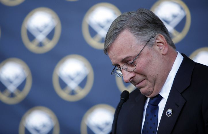 Buffalo Sabres new owner Terry Pegula tears up as he talks about former Buffalo Sabres player Gil Perreault during a news conference announcing the new ownership of the NHL hockey team in Buffalo, N.Y., Tuesday, Feb. 22, 2011. (AP Photo/David Duprey)
