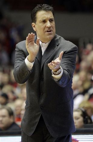 FILE - In this Feb. 13, 2011, file photo, St. John's head coach Steve Lavin urges his team on during an NCAA college basketball game against Cincinnati in Cincinnati. Lavin has more than lived up to the hype surrounding his move from the TV table to coaching St. John's. Just check the Top 25. (AP Photo/Al Behrman, File)