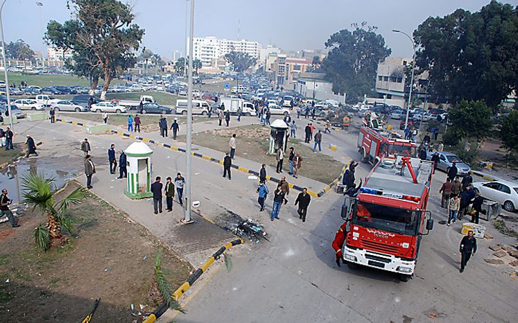 Fire trucks attend to the scene around a security forces compound, some buildings of which were burned including a guard post, center, in Benghazi, Libya on Monday, Feb. 21, 2011. Libyan protesters celebrated in the streets of Benghazi on Monday, claiming control of the country's second largest city after bloody fighting, and anti-government unrest spread to the capital with clashes in Tripoli's main square for the first time. (AP Photo/Alaguri)
