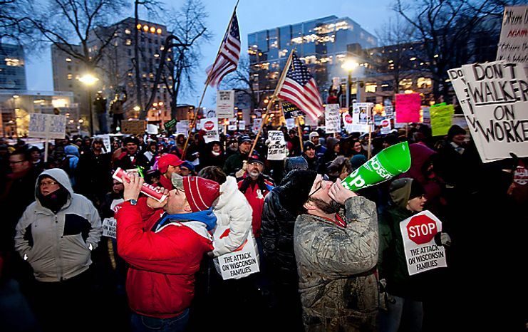 John Henneman, left, and Dan Kuhl, right, teachers from Wisconsin Rapids, protest Monday night, Feb. 21, 2011 outside the King Street entrance to the Capitol in Madison, Wis. No resolution appeared imminent Monday to the stalemate over union rights in Wisconsin, leaving Senate Republicans resigned to fo