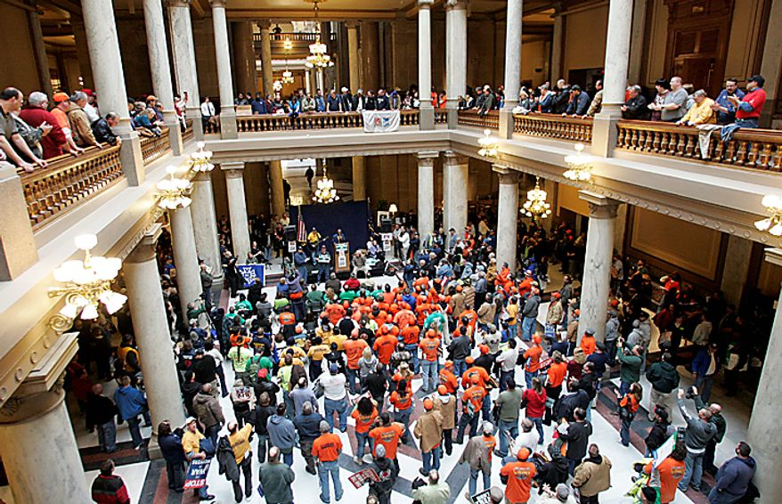 Demonstrators rally at the Indiana Statehouse in Indianapolis on Tuesday, Feb. 22, 2011. Hundreds of union members crowded the hallways to protest of a contentious labor bill. (AP Photo/Tom Strattman)