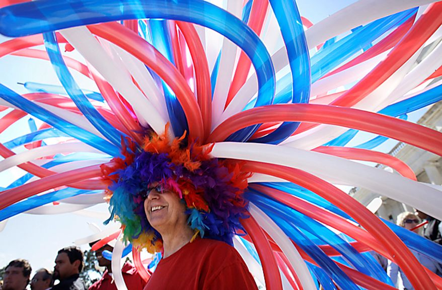 Union member Mark Wetzel of Hot Sprngs, Ark., wears a hat made from balloons at a rally in support of Wisconsin union members at the Arkansas state Capitol in Little Rock, Ark., on Tuesday, Feb. 22, 2011. (AP Photo/Danny Johnston)