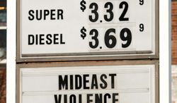 A sign advertises gas and diesel prices, plus gives an explanation to customers, at a service station in Easthampton, Mass., on Wednesday. (Associated Press)