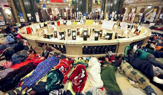 Opponents of Wisconsin Gov. Scott Walker's budget bill sleep in the Rotunda of the state Capitol in Madison, Wis., on Tuesday, Feb. 22, 2011. (AP Photo/Wisconsin State Journal, John Hart)