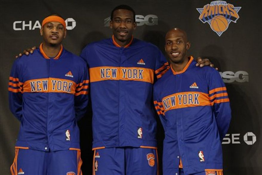 New York Knicks Carmelo Anthony, left, and Chauncey Billups, right, pose for photographs with teammate Amar'e Stoudemire, center, before NBA basketball game against the Milwaukee Bucks Wednesday, Feb. 23, 2011, in New York.  (AP Photo/Frank Franklin II)