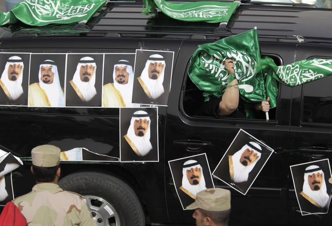 Saudis cruise the streets with car covered with Saudi flags and pictures of the Saudi King Abdullad and Saudi Crown Prince Sultan after the convoy of the King Abdullah of Saudi Arabia passes from the Airport and through the streets of Riyadh, Saudi Arabia, Wednesday, Feb. 23, 2011. King Abdullah returned Wednesday from a three-month absence for back surgery in New York and convalescence in Morocco. (AP Photo/Hassan Ammar)