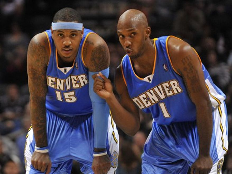 FILE - This Dec. 5, 2009, file photo shows Denver Nuggets players Carmelo Anthony (15) and Chauncey Billups during a teammate's free throw attempt in the second half of an NBA basketball gameagainst the San Antonio Spurs,  in San Antonio. The Nuggets are saddened that All-Star Carmelo Anthony's trade demands meant they had to say goodbye to hometown favorite Chauncey Billups, too. (AP Photo/ Bahram Mark Sobhani, File)