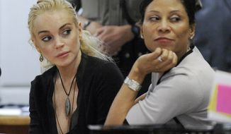 ** FILE ** Actress Lindsay Lohan (left) appears in Los Angeles Superior Court with her attorney, Shawn Chapman Holley, on Wednesday, Feb. 23, 2011, for a hearing on charges that the starlet stole a $2,500 necklace. (AP Photo/Paul Buck, Pool)