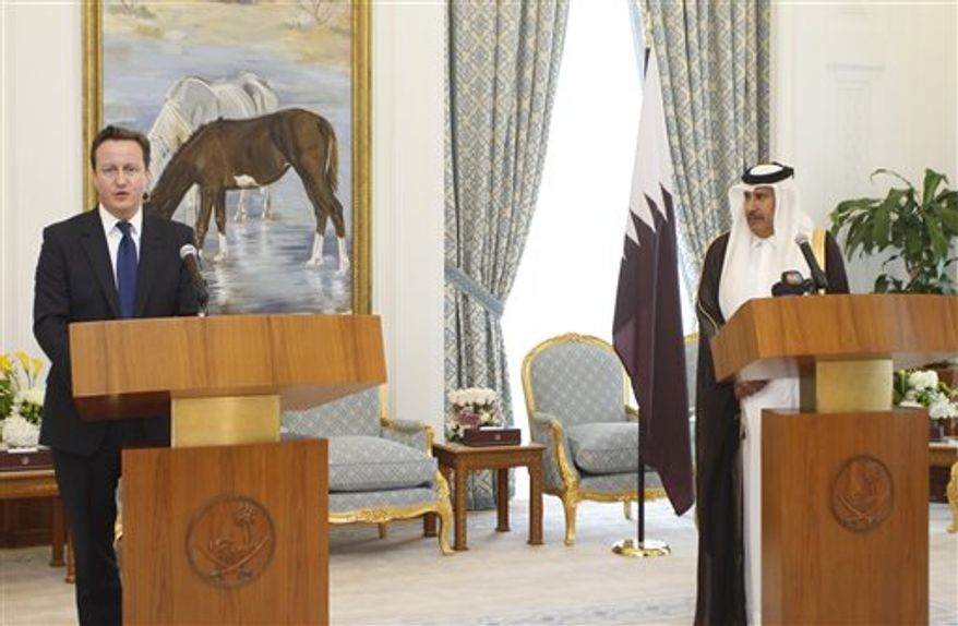 "British Prime Minister David Cameron speaks during a joint press conference with Qatari Premier and Foreign Minister Sheikh Hamad bin Jassem bin Jabr al-Thani, in Doha, Wednesday Feb. 23, 2011. During a question and answer session with students at Qatar University, Cameron said there should be ""consequences"" for the Libyan regime if it continued to use ""appalling levels of violence"" against its own people, and that he would like to see a United Nations Security Council resolution to send ""a very clear warning"" to Col. Gadhafi and the Libyan armed forces that what they were doing was ""wrong and against the law"".(AP Photo/Osama Faisal)"