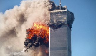 ** FILE ** The World Trade Center terror attacks in New York on Sept. 11, 2001. (Associated Press)