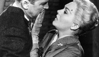 """Jimmy Stewart and Kim Novak are shown in a scene from Alfred Hitchcock's 1958 film """"Vertigo."""" The film is among the American Film Institute's best genre movies. (Associated Press/Paramount)"""