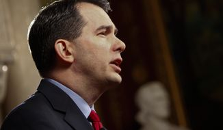 "** FILE ** Wisconsin Gov. Scott Walker rehearses his ""fireside chat"" with voters at the state Capitol in Madison, Wis., on Tuesday, Feb. 22, 2011. (AP Photo/Andy Manis)"