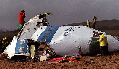 """In this Dec 22, 1988 file photo  Police and investigators look at what remains of the flight deck of Pan Am 103 on a field in Lockerbie, Scotland.  Swedish tabloid Expressen said Wednesday Feb. 23, 2011 that Libya's recently resigned justice minister claims Moammar Gadhafi personally ordered the Lockerbie bombing that killed 270 people in 1988.  Expressen quotes Mustafa Abdel-Jalil as telling their correspondent in Libya that """"I have proof that Gadhafi gave the order about Lockerbie."""" The comments were translated from Arabic to Swedish. (AP Photo/File)"""