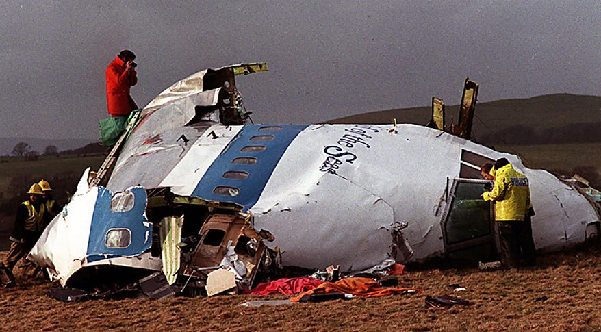 "In this Dec 22, 1988 file photo  Police and investigators look at what remains of the flight deck of Pan Am 103 on a field in Lockerbie, Scotland.  Swedish tabloid Expressen said Wednesday Feb. 23, 2011 that Libya's recently resigned justice minister claims Moammar Gadhafi personally ordered the Lockerbie bombing that killed 270 people in 1988.  Expressen quotes Mustafa Abdel-Jalil as telling their correspondent in Libya that ""I have proof that Gadhafi gave the order about Lockerbie."" The comments were translated from Arabic to Swedish. (AP Photo/File)"