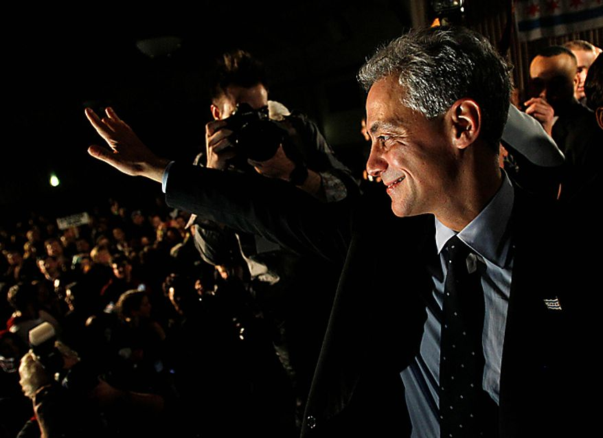 Former White House Chief of Staff Rahm Emanuel smiles at the crowd after winning the Chicago mayoral race on Tuesday, Feb. 22, 2011. Mr. Emanuel easily overwhelmed five rivals in order to take the helm of the nation's third-largest city as it prepares to chart a new course without the retiring Mayor Richard M. Daley. (AP Photo/Charles Rex Arbogast)